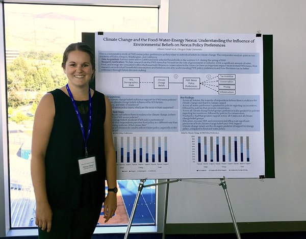 OSU student giving a poster presentation at an energy conference