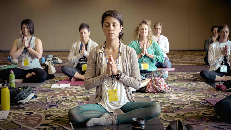 People sitting for a meditation program