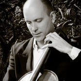 Michal Palcewicz playing cello
