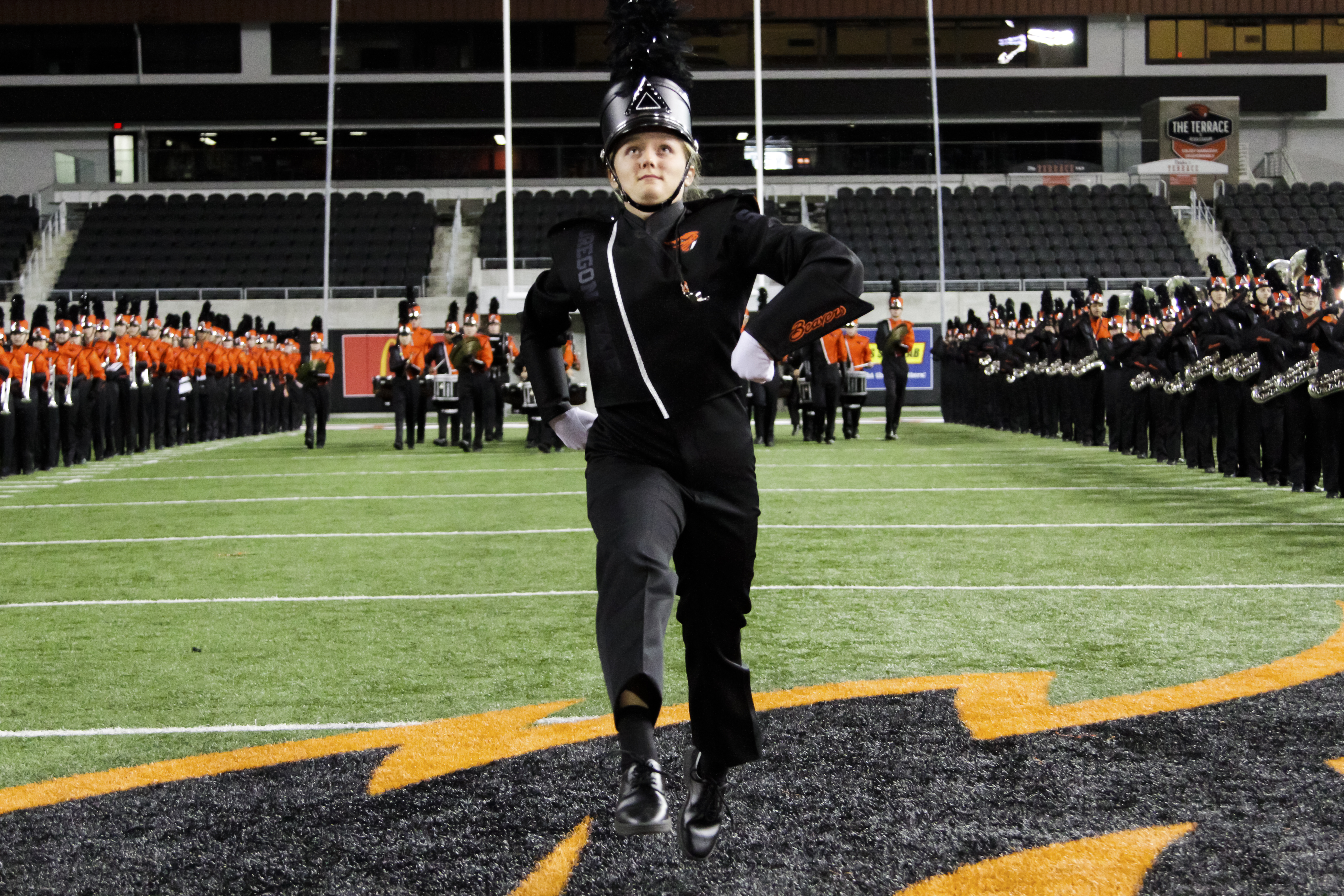 A drum major on the field.