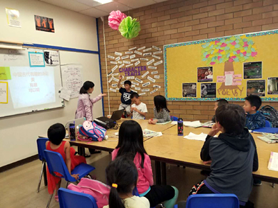 Students learning poetry in a colorful classroom