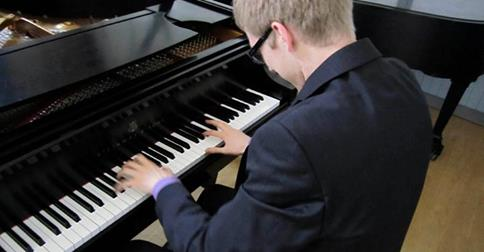 Male Piano Student Playing Steinway Piano