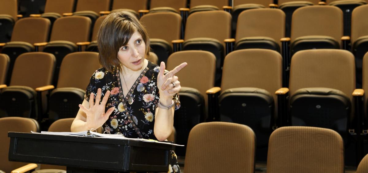 OSU theatre coordinator Dr. Elizabeth Helman presenting a lecture