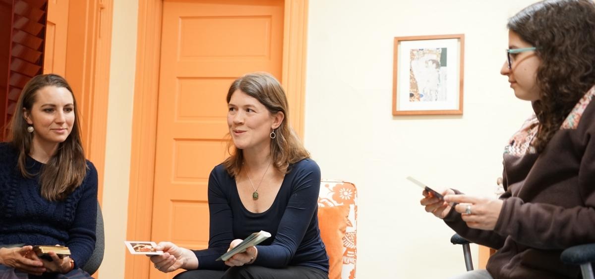 Photo of Emily Yates-Doerr speaks with graduate students