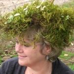 Artist Deirdre Hyde side view with moss wreath