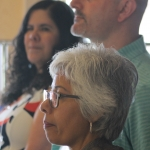 Faculty members listening to presentations.