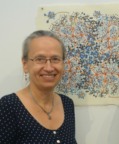 Artist April Vollmer with her work in Tokyo