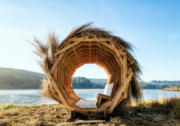 Erin Moore wooden portal structure on beach with blue sky