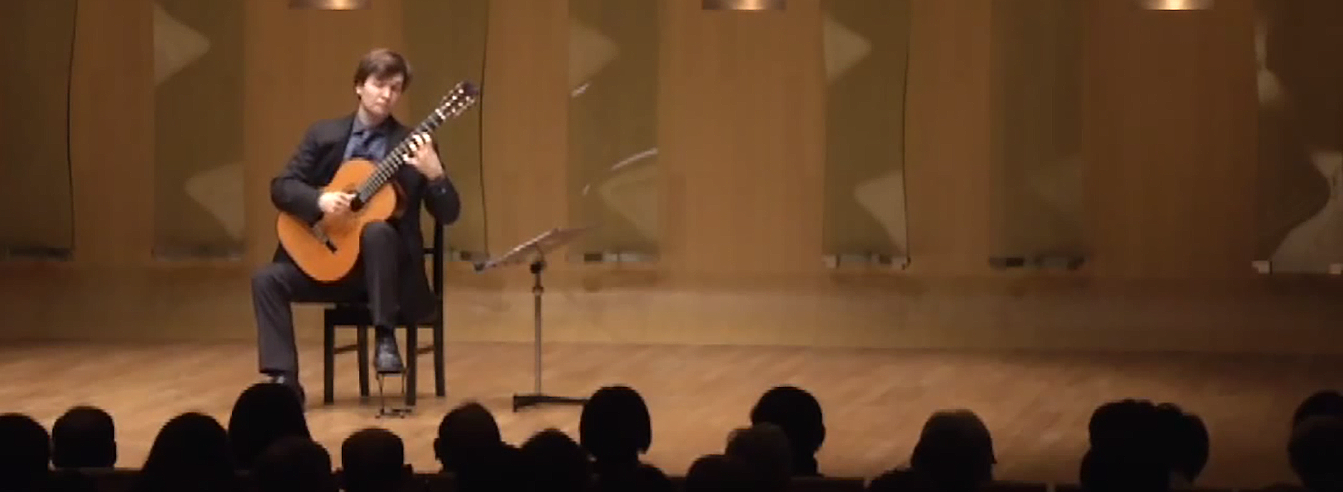Cameron O'Connor performing in the finals of the Tokyo Guitar Competition.