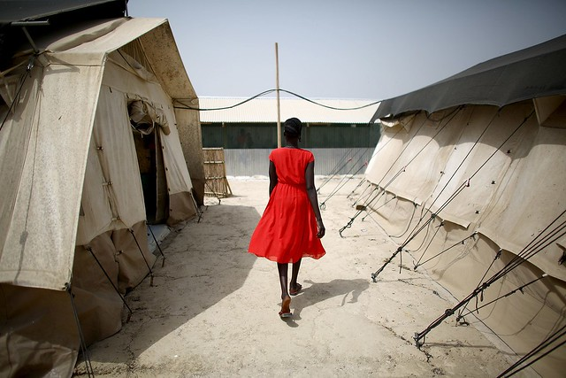 Woman Walking - Photograph by David Gilkey